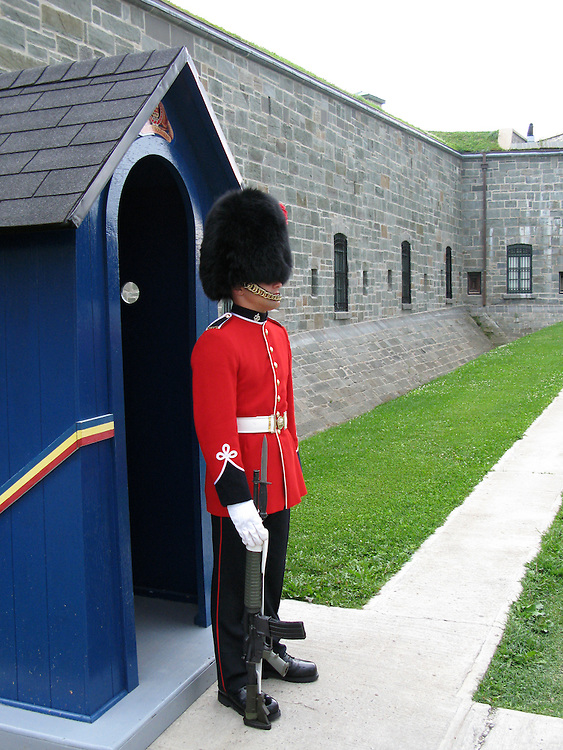 July 19, 2008 - Quebec City, QC. Guard dressed in uniform staying at the gate in the Citadel in Quebec City, QC, Canada. Citadel is a residence of the Governor General (Canada's Head of State), functioning army base and a tourist attraction.