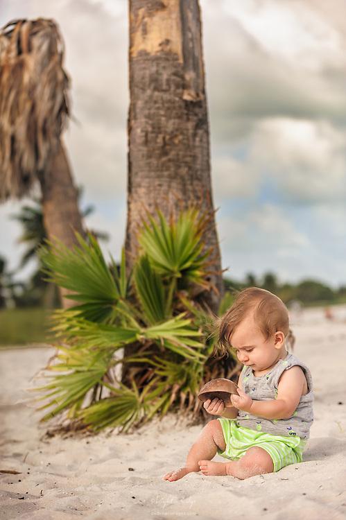 Lucas exploring items on Sombrero Beach in Marathon, FL.