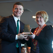 """Queenstown Mayor Vanessa van Uden presents a gift to Brian O""""Driscoll at the Irish teams Civic welcome at Skyline.  Queenstown, New Zealand, 4th September 2011. Photo Tim Clayton..."""