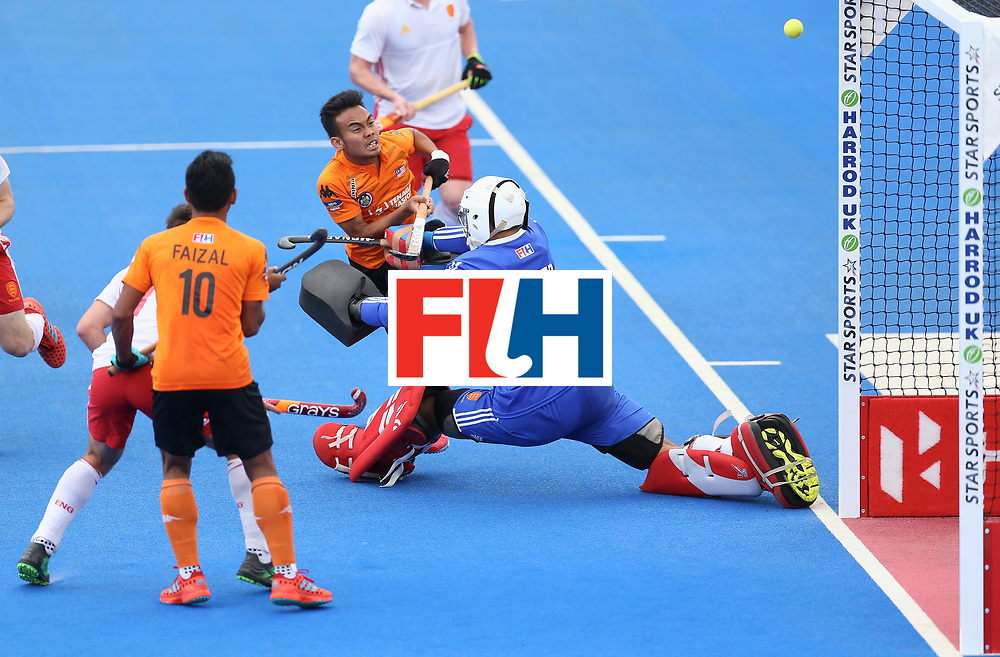 LONDON, ENGLAND - JUNE 25:  Azuan Hasan of Malaysia has a shot saved by George Pinner of England during the 3rd/4th place match between Malaysia and England on day nine of the Hero Hockey World League Semi-Final at Lee Valley Hockey and Tennis Centre on June 25, 2017 in London, England.  (Photo by Steve Bardens/Getty Images)