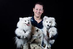 © Licensed to London News Pictures. 11/03/2016. Birmingham, UK. Kim Bailey with her Japanese Spitzs named Kishi and Furi at Crufts 2016 held at the NEC in Birmingham, West Midlands, UK. The world's largest dog show, Crufts is this year celebrating it's 125th anniversary. The annual event is organised and hosted by the Kennel Club and has been running since 1891. Photo credit : Ian Hinchliffe/LNP