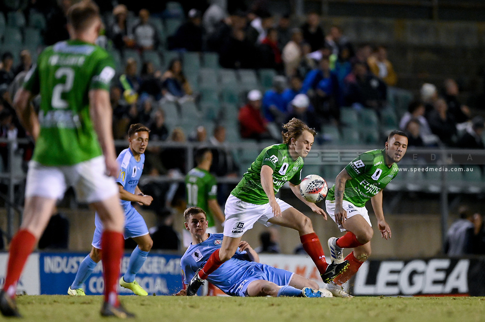 SYDNEY, AUSTRALIA - AUGUST 21: Marconi Stallions player Connor Evans (8) gets past Melbourne City player Connor Metcalfe (34) during the FFA Cup round of 16 soccer match between Marconi Stallions FC and Melbourne City FC on August 21, 2019 at Marconi Stadium in Sydney, Australia. (Photo by Speed Media/Icon Sportswire)