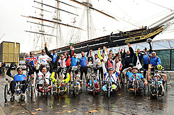 © Licensed to London News Pictures. 11/10/2012. 30 British and American wounded soldiers and veterans are welcomed by school children from St Alfege with St Peters School Greenwich. after riding into London, today 11 October 2012, after completing 'Soldier Ride'  The 30 serving and formers soldiers, all with life-changing injuries sustained in the line of duty, departed from Sandringham Estate, waved off by His Royal Highness the Duke of Edinburgh last Saturday. They travelled the Norfolk, Suffolk and Essex coast calling at Cromer, Great Yarmouth, Ipswich, Colchester, Southend-on-Sea, Rainham all the way to the finish line in Greenwich, London.  Riders used modified bikes, hand cycles and standard road bikes, depending on their needs. Photo credit : Rob Leyland/LNP