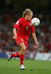 CARDIFF, WALES - Wednesday, September 8, 2004: Wales' Craig Bellamy in action against Northern Ireland during the Group Six World Cup Qualifier at the Millennium Stadium. (Pic by David Rawcliffe/Propaganda)
