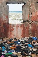 Flip Flop Lost and Found on Bonaire. ISE/SAS Spring 2010 Enrichment Caribbean Voyage, Nikonians Ultimate Travel Workshop. UTW-I Day 9: Bonaire. Image taken with a Nikon D3x and 50 mm f/1.4G lens (ISO 100, 50 mm, f/5.6, 1/30 sec).