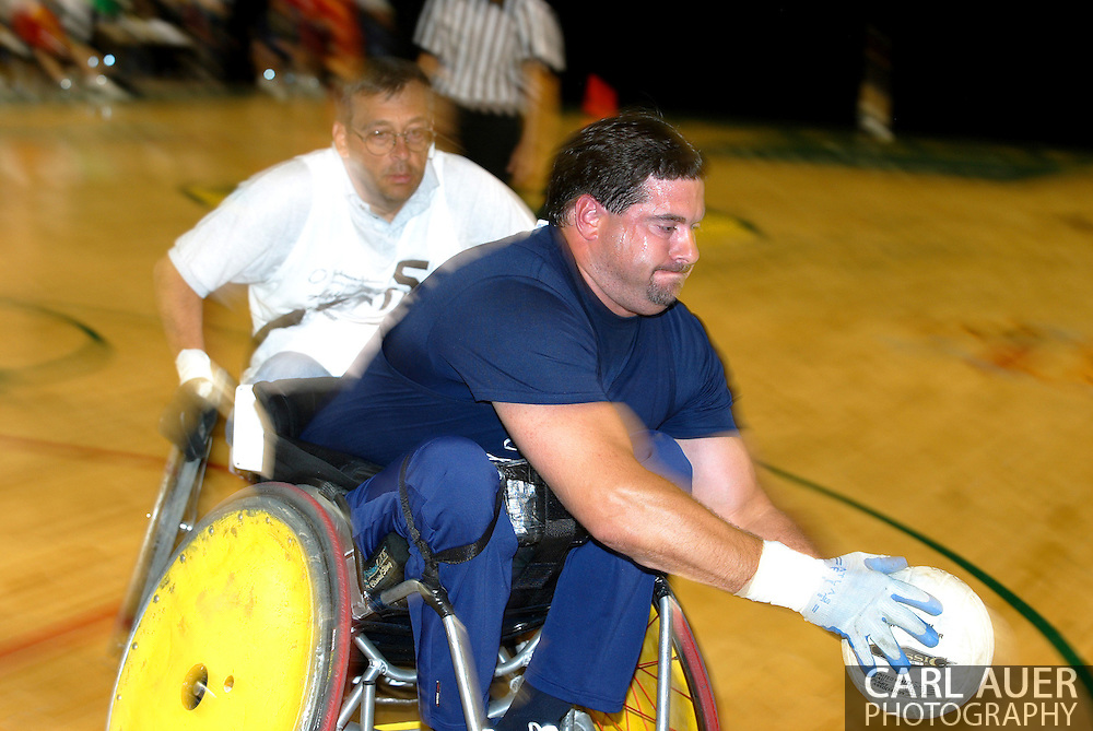July 7th, 2006: Anchorage, AK - Scot Severn (9) reaches for a pass as White defeated Blue in the gold medal game of Quad Rugby at the 26th National Veterans Wheelchair Games.
