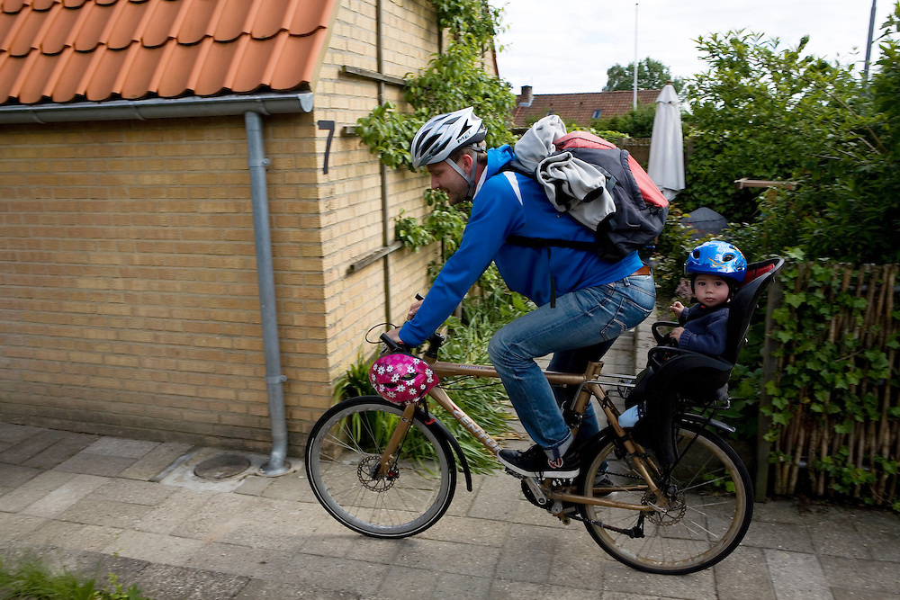 Aarhus, Denmark, June 17th, 2010. Thomas  back from day-care with his son Theo. Thomas took two months of paternity leave to care for children while his wife Vinne works.