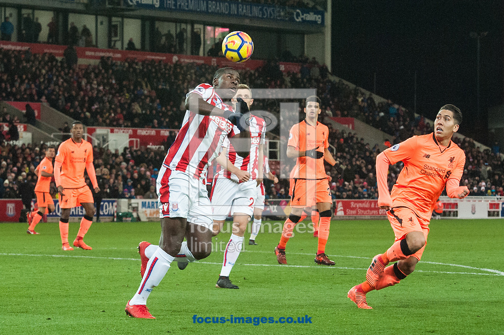 Kurt Zouma of Stoke City heads clear of Roberto Firmino of Liverpool during the Premier League match at the Bet 365 Stadium, Stoke-on-Trent<br /> Picture by Matt Wilkinson/Focus Images Ltd 07814 960751<br /> 29/11/2017