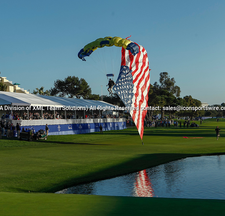 February 8, 2015:  Sky divers bring the trophy and American flag to the award ceremony on the Torrey Pines Golf Course during the final round of the Farmers Insurance Open in San Diego, Ca.