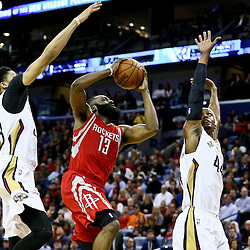 Jan 25, 2016; New Orleans, LA, USA; Houston Rockets guard James Harden (13) drives between New Orleans Pelicans forward Anthony Davis (23) and forward Dante Cunningham (44) during the second quarter of a game at the Smoothie King Center. Mandatory Credit: Derick E. Hingle-USA TODAY Sports
