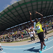 Usain Bolt, Jamaica, celebrates with fans after his win in the Men's 200m during the Diamond League Adidas Grand Prix at Icahn Stadium, Randall's Island, Manhattan, New York, USA. 13th June 2015. Photo Tim Clayton