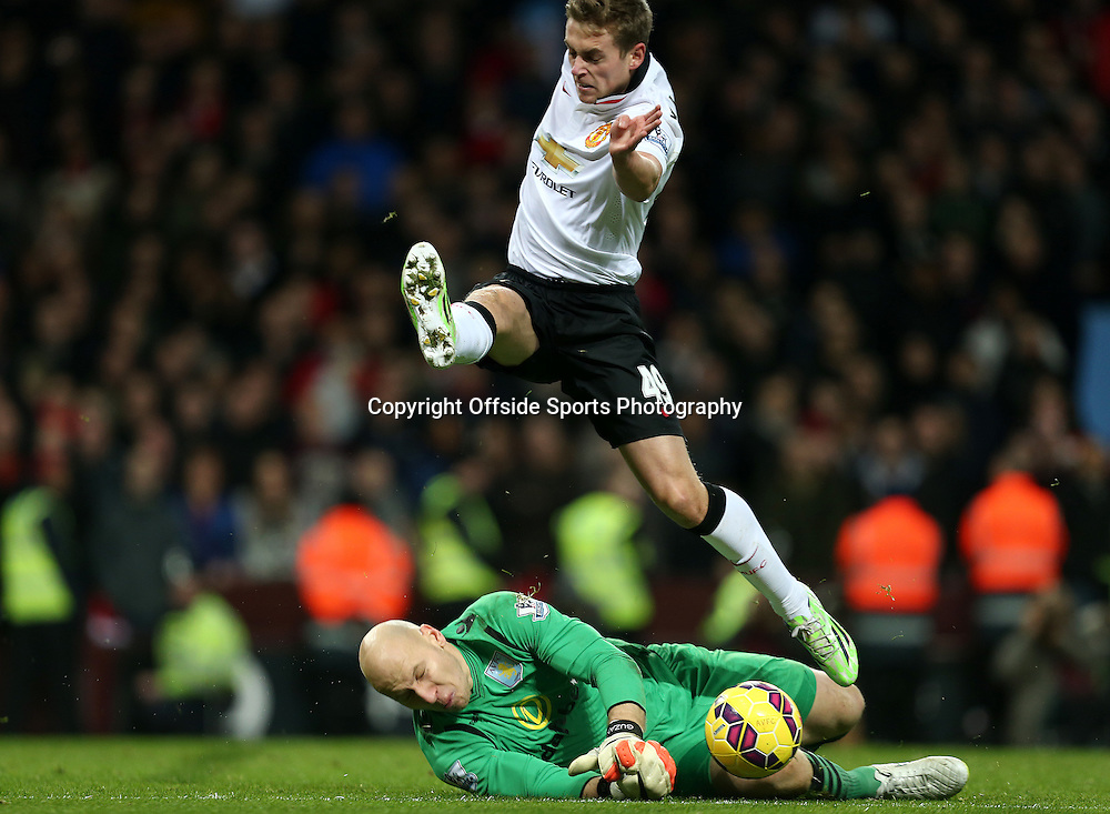 20th December 2014 - Barclays Premier League - Aston Villa v Manchester United - James Wilson of Manchester United is stopped by Aston Villa keeper Brad Guzan - Photo: Paul Roberts / Offside.