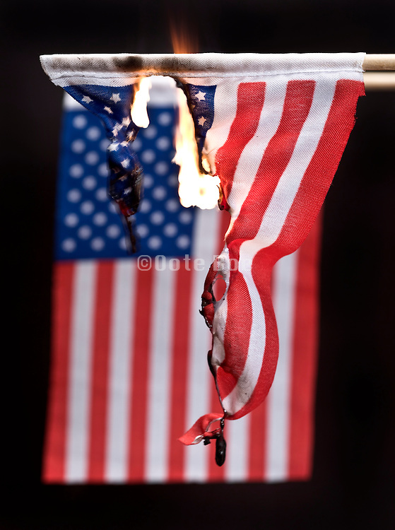 burning American flag against a black background