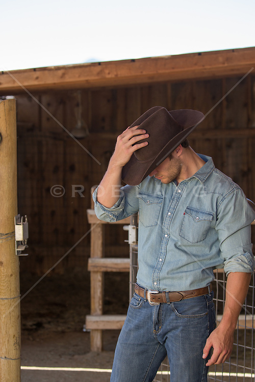 good looking cowboy in a barn
