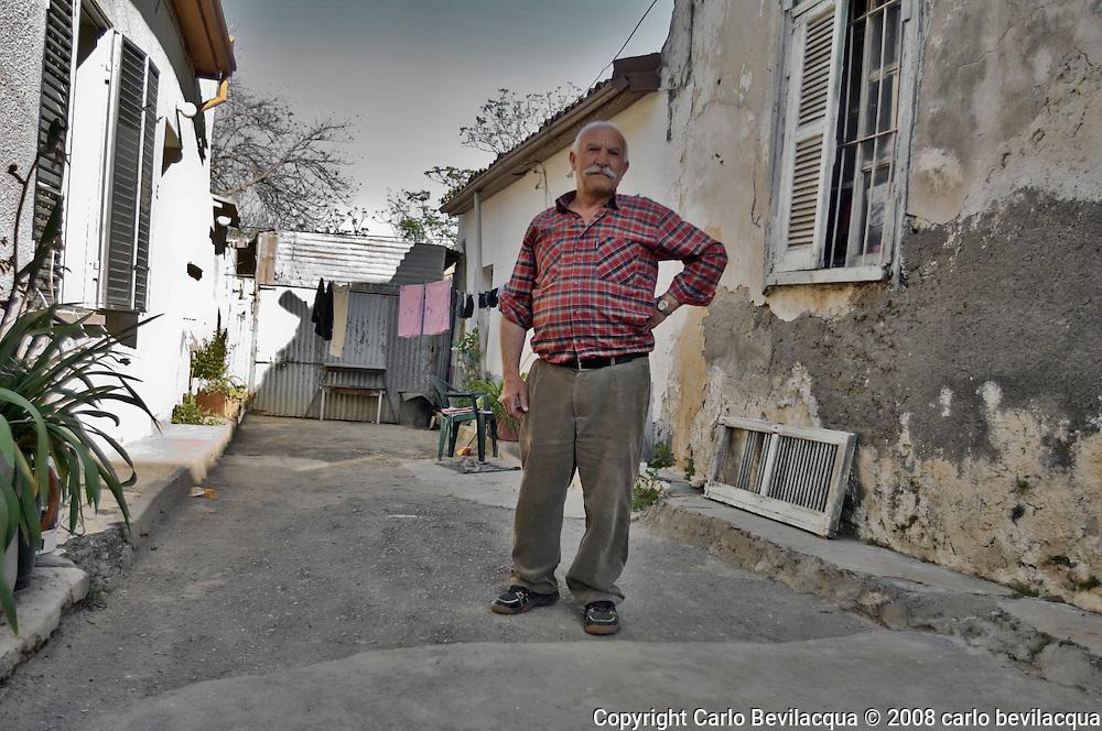 Memet ex autista di Camion. Nel vicolo,  davanti casa di una parente, chiuso da un muro costruito dall'esercito Turco. <br /> Memet_LorryDriver_in_a_Court_