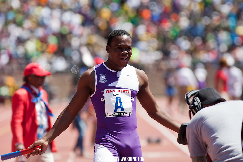 Tevin-Lloyd Thompson of Kingston College (Jamaica) poses for the camera after crossing the finish line first following the High School Boys' 4x100 Championship of America at the 119th Penn Relays on Saturday, April 27, 2013 in Philadelphia, PA.