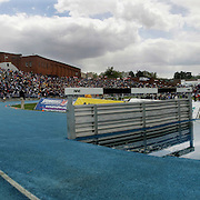 Runners take the water barrier in the men's 3,000 meter steeplechase at the Drake Relays held at Drake University in Des Moines, Iowa.   The annual track meet is one of the biggest in the United States, drawing high school, collegiate and Olympic athletes.  2009 will mark the 100th anniversary of the event.