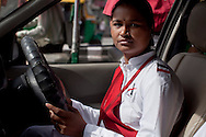 Ekta Yadav aged 28 on the streets of Delhi on 30th March 2010.<br /> These female drivers were part of a program by Azad Foundation.<br /> Currently training their 4th batch of students, Azad Foundation was set up by Meenu Vadera (Executive Director) in New Delhi, India, to train Indian women in driving services. Upon completion, these women work as personal drivers for a period of time before they upgrade their driving licences to commercial licences, allowing them to drive taxis. With this program, Azad aims to empower Indian women including those previously abused or trafficked, while making Delhi a safer place for women travelling in public transport. Photo by Suzanne Lee for Panos London
