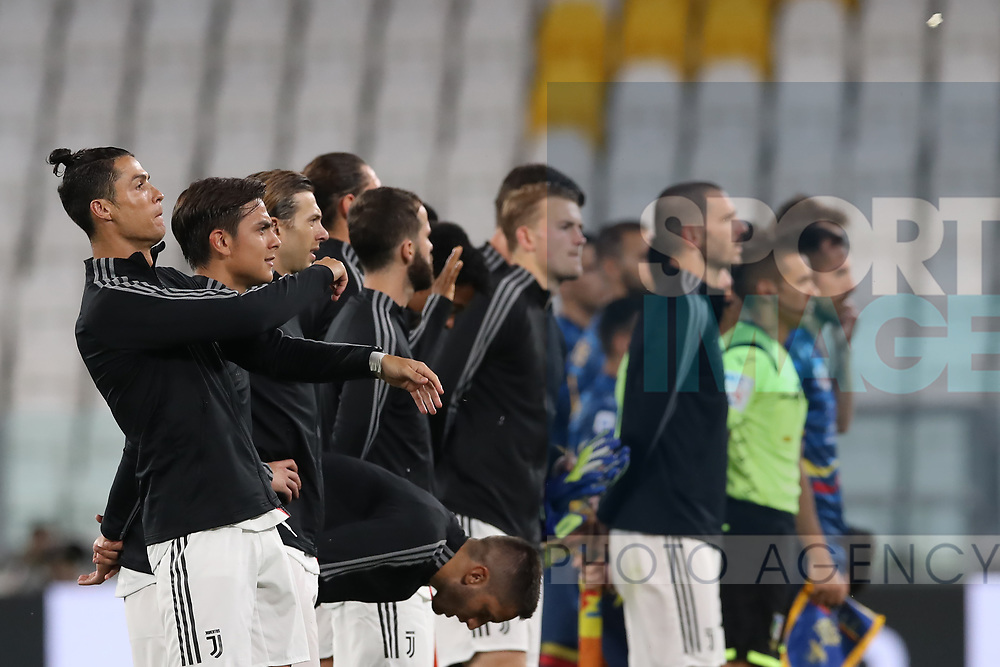 Juventus's Portuguese striker Cristiano Ronaldo throws a piece of what appears to be tape during the line up before the Serie A match at Allianz Stadium, Turin. Picture date: 26th June 2020. Picture credit should read: Jonathan Moscrop/Sportimage