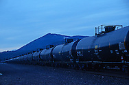 BNSF train with oil tank cars travelling through Troy in Lincoln County, northwest Montana.