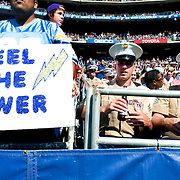 Military members enjoy a Chargers game.