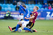 Macclesfield Town midfielder Jay Harris challenged by  Bradford City midfielder Chris Taylorduring the EFL Sky Bet League 2 match between Macclesfield Town and Bradford City at Moss Rose, Macclesfield, United Kingdom on 30 November 2019.