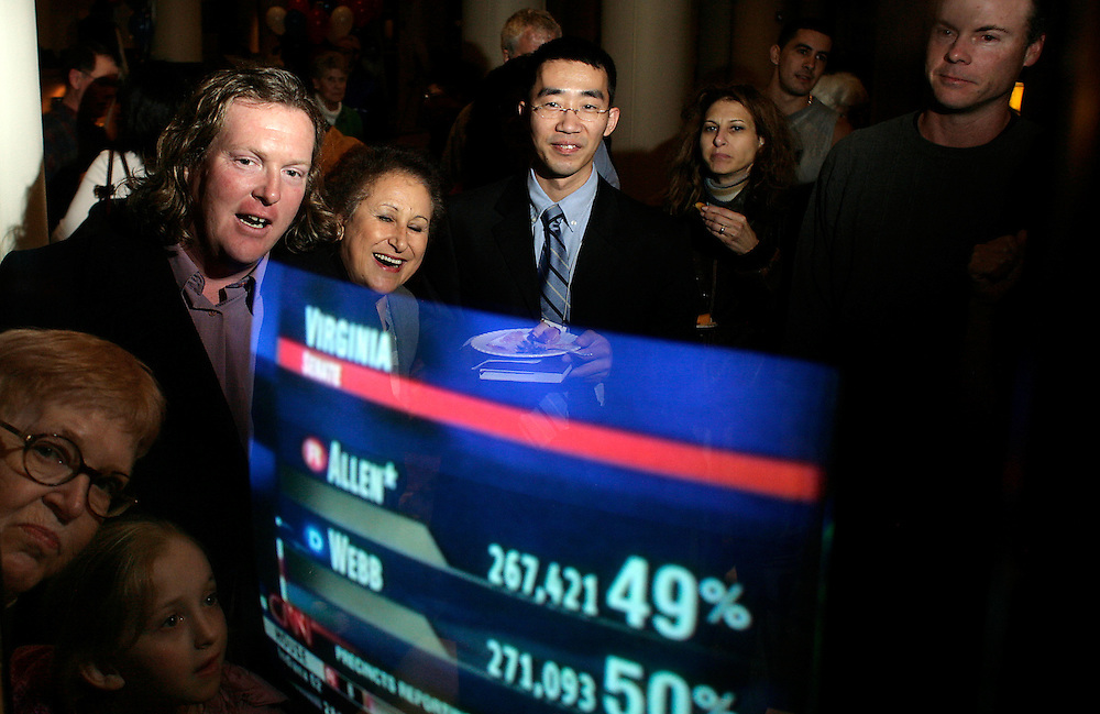 """Supporters of Democratic candidate for the Senate from Virginia, James Webb, watch early returns come in at the """"victory"""" party on November, 8, 2006."""
