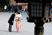 A kimono-clad Japanese woman is accompanied by her boyfriend after a a ceremony held to celebrate coming of age for Japanese 20-year-olds in Tokyo, Japan.