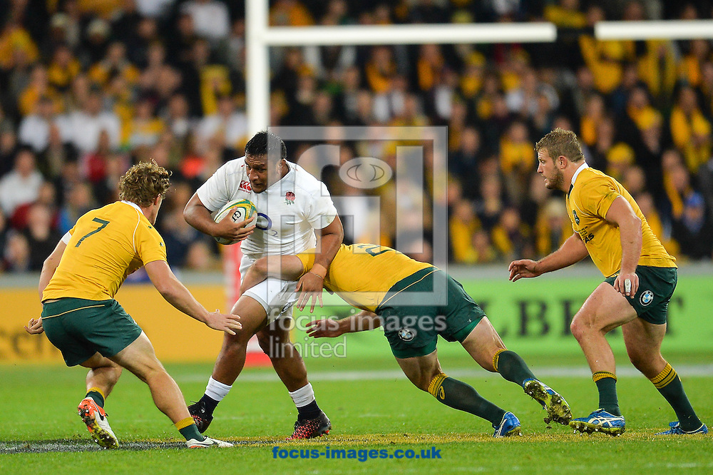 Mako Vunipola of England is tackled by Stephen Moore of Australia  and  Michael Hooper of Australia during the International Test Match match at AAMI Stadium, Melbourne<br /> Picture by Frank Khamees/Focus Images Ltd +61 431 119 134<br /> 18/06/2016