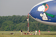 Montgomery, NY- A member of the ground crew climbs the mooring mast to prepare the Met Life blimp Snoopy Two for take off from Orange County Airport on July 26, 2008.