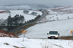© Licensed to London News Pictures. 28/02/2017. Mynydd Epynt, Powys, Wales, UK. A motorist drives along the B4520  'Brecon Road' on the high moorland of the Mynydd Epynt range between Builth Wells and Brecon in Powys, Wales, UK  as driving wind and snow hits the high land in Powys, Wales, UK. About 6cm of snow fell last night on high land. Photo credit: Graham M. Lawrence/LNP