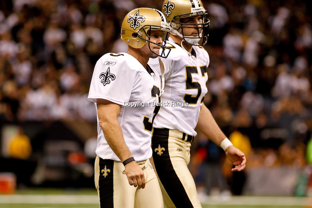 October 3, 2010; New Orleans, LA, USA; New Orleans Saints place kicker John Carney (3) walks back to the sideline with long snapper Jason Kyle during a game against the Carolina Panthers at the Louisiana Superdome. The Saints defeated the Panthers 16-14. Mandatory Credit: Derick E. Hingle