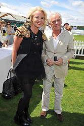 AMANDA ELIASCH and KEN ARMSTRONG  at the 27th annual Cartier International Polo Day featuring the 100th Coronation Cup between England and Brazil held at Guards Polo Club, Windsor Great Park, Berkshire on 24th July 2011.