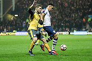 Arsenal defender Shkodran Mustafi (20)  and Callum Robinson (Preston North End) battle during the The FA Cup 3rd round match between Preston North End and Arsenal at Deepdale, Preston, England on 7 January 2017. Photo by Pete Burns.