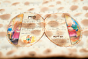 Open Matzo shaped Hagada on Matzo background
