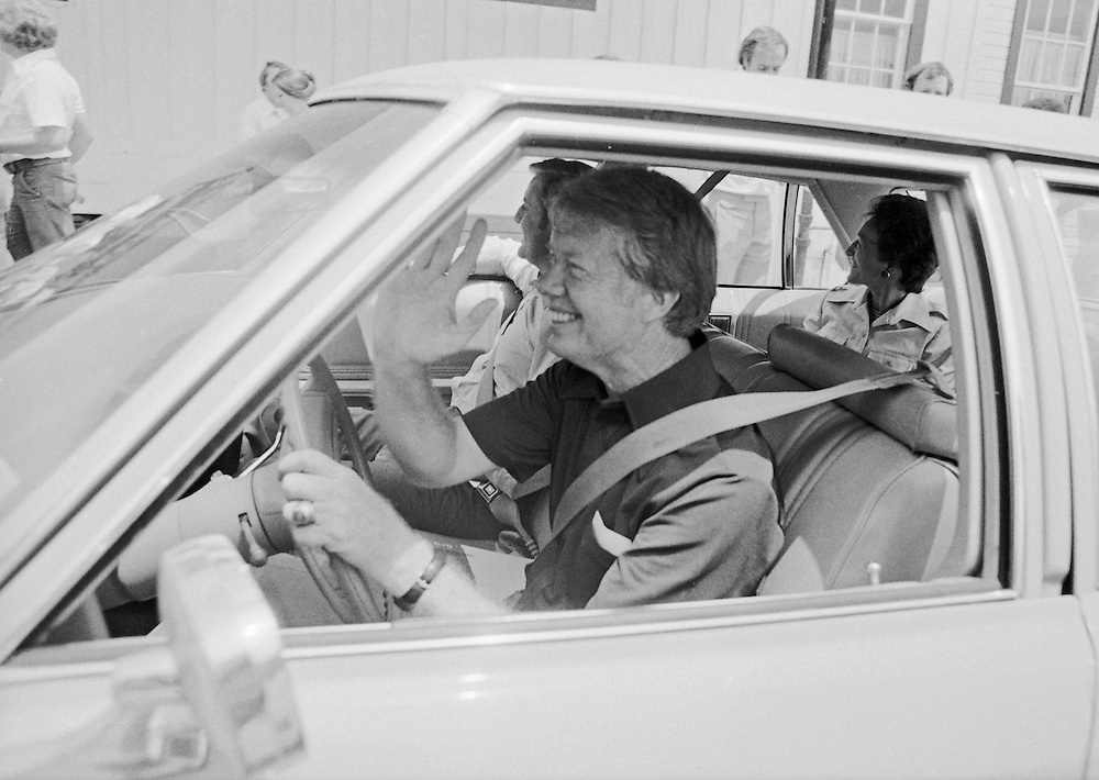 """1976 Democratic presidential nominee Jimmy Carter takes his running mate, Walter """"Fritz"""" Mondale and wife, Joan on a ride around carter's home town of Plains, Georgia. Much to the chagrin of the US Secret Service, Carter liked to drive his own car. - To license this image, click on the shopping cart below -"""