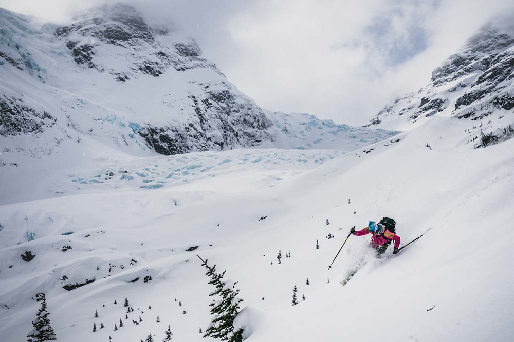Erme Catino dropping in above the Burnie Glacier, Howson Range, BC.