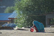 An unidentified girl brushes her teeth on the rooftop of her family home, Kargil