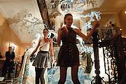 AMBER LE BON; BEN GRIMES; , Unveiling of the Dior Christmas Tree by John Galliano at Claridge's. London. 1 December 2009 *** Local Caption *** -DO NOT ARCHIVE-© Copyright Photograph by Dafydd Jones. 248 Clapham Rd. London SW9 0PZ. Tel 0207 820 0771. www.dafjones.com.<br /> AMBER LE BON; BEN GRIMES; , Unveiling of the Dior Christmas Tree by John Galliano at Claridge's. London. 1 December 2009