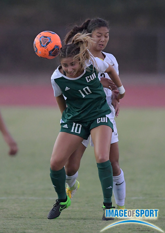 Concordia Eagles midfielder Marianna Maldonado (10) and Cal State Dominguez Hills Toros midfielder Naomi Willey (3) battle for the ball during a nonconference women's soccer match n Carson, Calif. on Friday, September 8, 2017. Concordia defeated CSUDH 3-1.