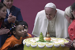 Vatican, Rome - December 16, 2018.Pope Francis blows the candle of cake for his 82nd birthday, offered to him during an audience for children and families of the Santa Marta dispensary on December 16, 2018 at the Vatican. - Pope Francis turns 82 on December 17, 2018. (Credit Image: © Maria Grazia Picciarella/Ropi via ZUMA Press)