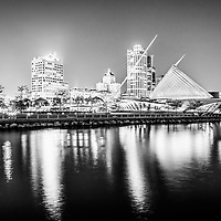 Milwaukee skyline at night picture in black and white. Photo includes the Milwaukee lakefront, Milwaukee Art Museum, University Club Tower, and Northwestern Mutual Tower. Photo is high resolution.