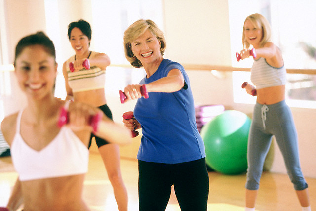 Fun in an aerobics class --- Image by © Jim Cummins/CORBIS