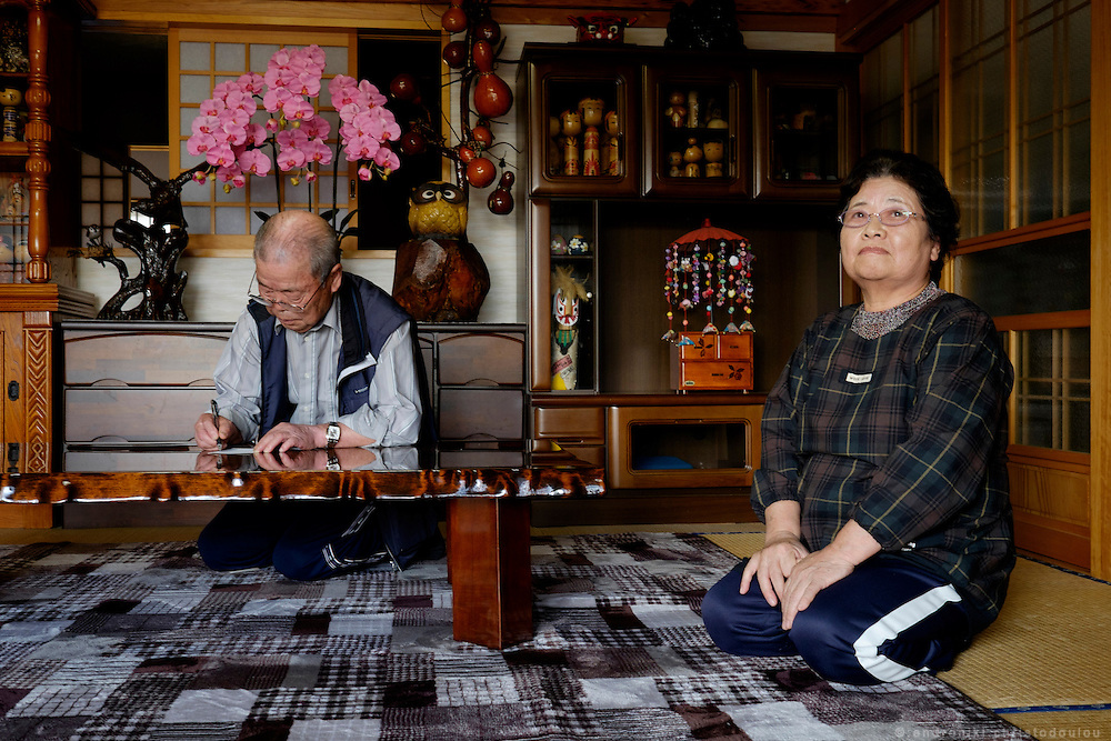 Kohei and Tomoko YAMAUCHI, elderly couple who returned to Naraha after the evacuation order was lifted, inside their house.