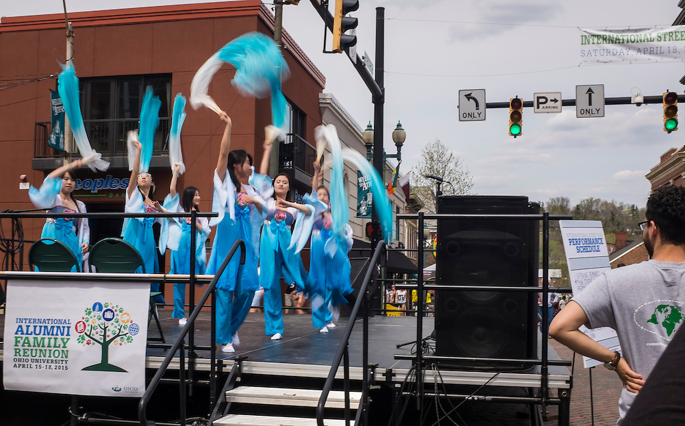 Dancers perform the Long Silk Fan Dance for the crowd at the intersection of Court and Washington during the International Street Fair on Saturday, April 18, 2015.  Photo by Ohio University  /  Rob Hardin