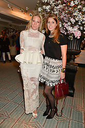 Left to right, ALICE NAYLOR-LEYLAND and PRINCESS BEATRICE OF YORK at the launch of Mrs Alice in Her Palace - a fashion retail website, held at Fortnum & Mason, Piccadilly, London on 27th March 2014.