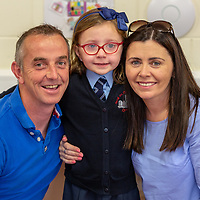 Sarah McGrath with parents Michelle and Tom on her first day at school at Scoil Na Mainistreach Quin Dangan