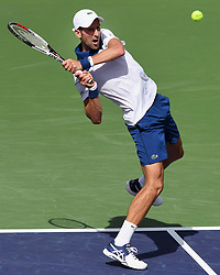 March 11, 2018 - Indian Wells, CA, U.S. - INDIAN WELLS, CA - MARCH 11: Novak Djokovic (SRB) hits a backhand shot in the second set of a match played at the BNP Paribas Open on March 11, 2018 at the Indian Wells Tennis Garden in Indian Wells, CA. (Photo by John Cordes/Icon Sportswire) (Credit Image: © John Cordes/Icon SMI via ZUMA Press)
