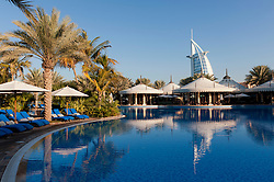 Swimming pool and restaurant pavilions in Al Qasr hotel at Jumeirah Madinat hotels complex in Dubai in United Arab Emirates