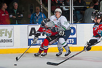 KELOWNA, CANADA - MARCH 18: Nick Holowka #39 of Seattle Thunderbirds checks Joe Gatenby #28 of Kelowna Rockets as he skates with the puck on March 18, 2015 at Prospera Place in Kelowna, British Columbia, Canada.  (Photo by Marissa Baecker/Shoot the Breeze)  *** Local Caption *** Nick Holowka; Joe Gatenby;